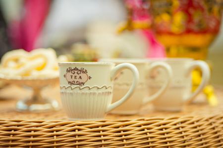 tea drinking outdoors. Tea cup and teapot russian samovar. Stock Photo