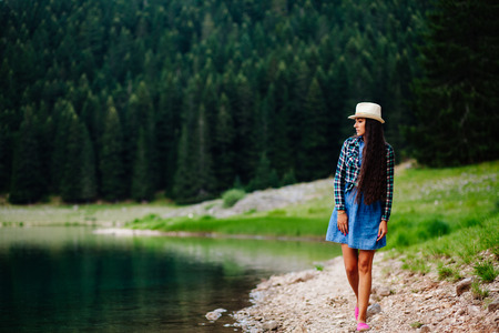 long lake: woman relax in pine forest and lake. Long hair woman travel Mountain lake.