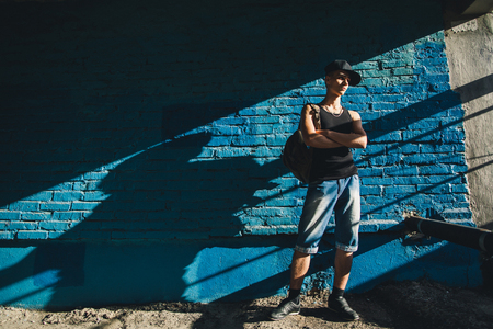 teenager walk with backpack. Hip hop teenager walk on street.