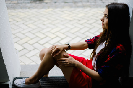 erotical: fancy long hair woman with mole on face. Beautiful woman relax on street