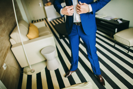 getting: man getting dressed. Manw getting ready to dress and business meeting.