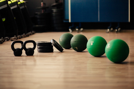 weights and medicine ball fitness background. Fitness and sport accessories