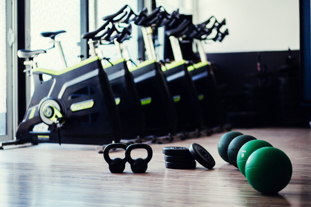 weightloss fitness accessories. Weights and cycling bikes Stock Photo