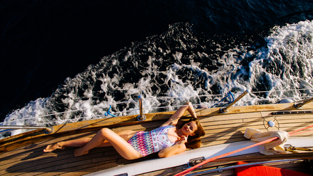 luxury woman yachting in sea. Sea waves background and top view.