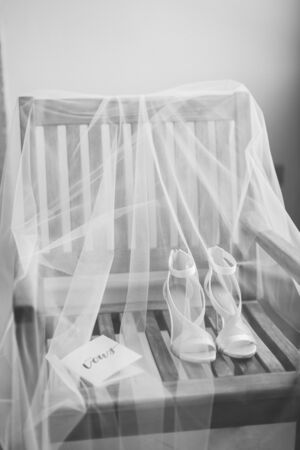 wedding shoes and veil background. Wedding shoes and wedding vow with veil background. Black and white.