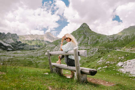 wind in hair woman relax at countryside with beautiful view