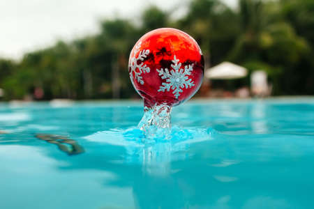 new year tree decoration splashes from the blue water