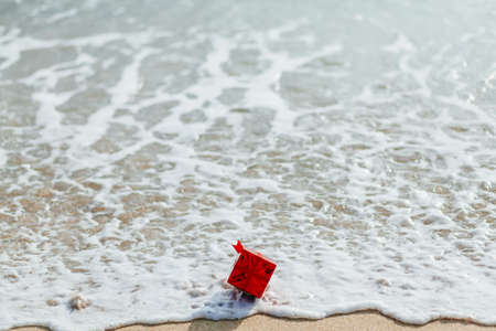 gift red box in the sea Stock Photo