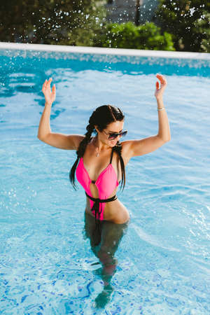 happy woman relax in swimming pool on summer vacations