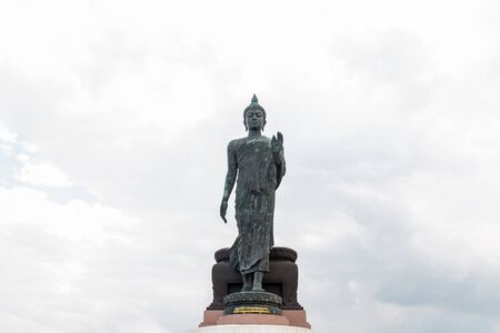 Front of Big Buddha Statue with blue sky in Thailand