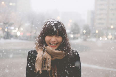 Snow on her hair and a smiling woman