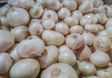 White onions bunch raw uncooked ready to sale in vegetable market