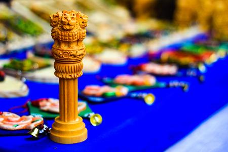 miniature wooden replica of Ashoka Stambha. An ancient historic indian monument.Lion face Pliiar of Ashoka, Indian national emblem. Stock Photo