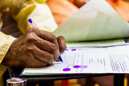 hand of an old man writing important legal document Banco de Imagens