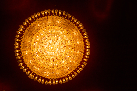 round ceiling chandelier light at durga puja pandal worship