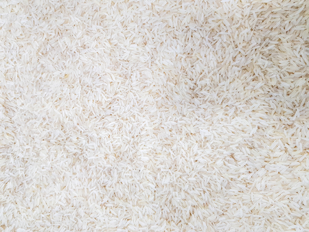 raw uncooked heap of rice at supermarket for sale