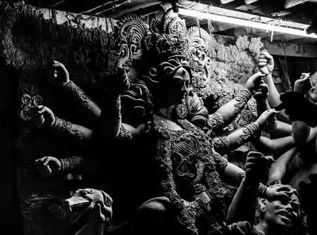 Kumartuli,West Bengal, India, July 2018. A clay idol of Goddess Durga under construction at a shop during night. Durga puja is the most awaited hindu festival in eastern India and worldwide.