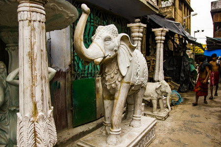 Kumartuli,West Bengal, India, July 2018. A clay statue of a elephant under construction at a shop during day time for sale Редакционное