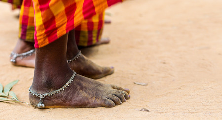 dirty bare feet of tribal female dancer in saree with anklet in tribal dance pose stance on ground Stok Fotoğraf