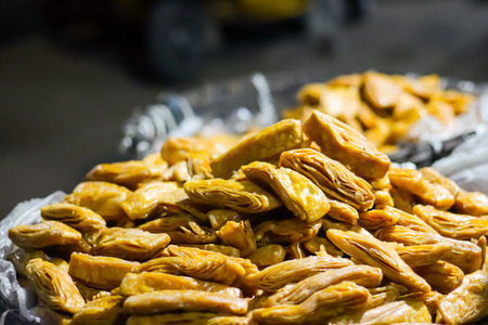 Khaja Snacks,Layered Fritters Dunked In Sugar Syrup, for sale. Stock Photo