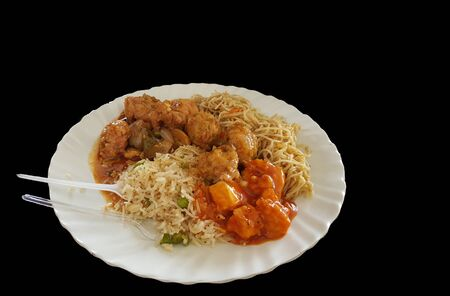 chinese food noodle and chilli chicken gravy on a plate with black background with space for text