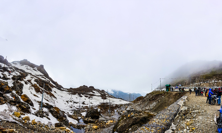 July,2018,Nathu-La, Sikkim, India. A panoramic view of Nathu-La pass with tourists and parked cars.at Sikkiim, India. Nathu-La marks the Indo Chinese border and is a very popular tourist attraction Editorial