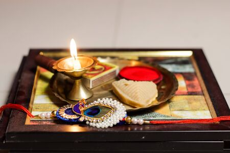 a plate thali decorated with rakhi sweet lamp diya for the occasion of rakshabandhan greeting of brother and sister Zdjęcie Seryjne - 129249086