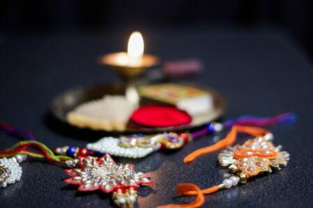 a plate thali decorated with rakhi sweet lamp diya for the occasion of rakshabandhan greeting of brother and sister Zdjęcie Seryjne