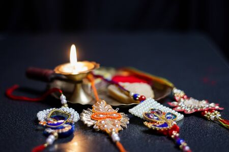 a plate thali decorated with rakhi sweet lamp diya for the occasion of rakshabandhan greeting of brother and sister Zdjęcie Seryjne - 129249138