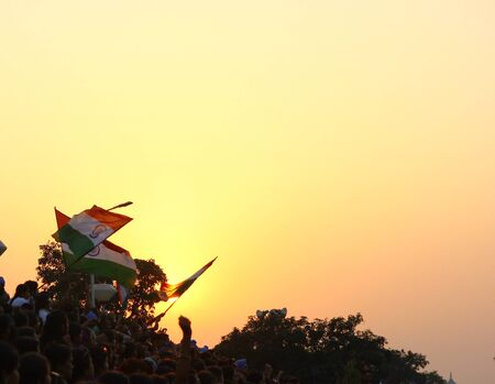 August 15,2018, Wagha Border, Amritsar, India. Indian flag waved by crowd during sunset at Wagha, India Pakistan Border at Amritsar India during Indian Independance day 2018.