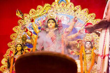 hazed picture of goddess durga in background of smoke of worship Reklamní fotografie
