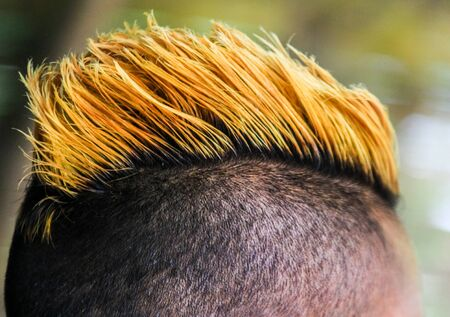 mohawk hair style close up view with yellow dye of hair
