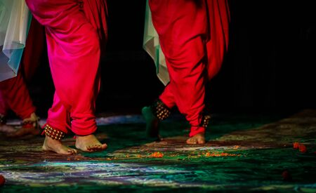 indian classical dance form in feet with musical anklet with selective focus and blur Stock Photo - 129925215