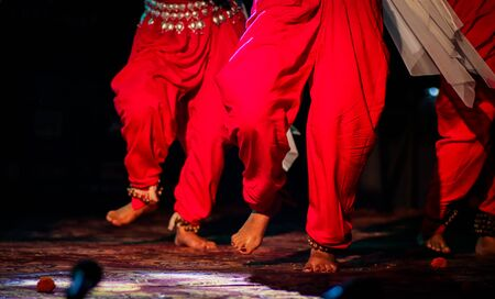 indian classical dance form in feet with musical anklet with selective focus and blur Stock Photo - 129925236