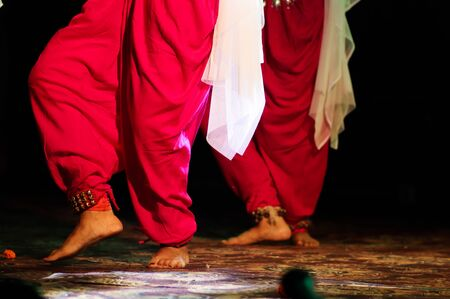 indian classical dance form in feet with musical anklet with selective focus and blur