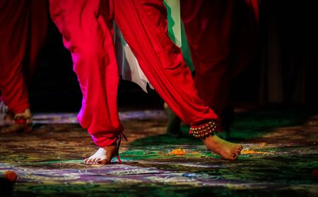 indian classical dance form in feet with musical anklet with selective focus and blur Stock Photo - 129925241