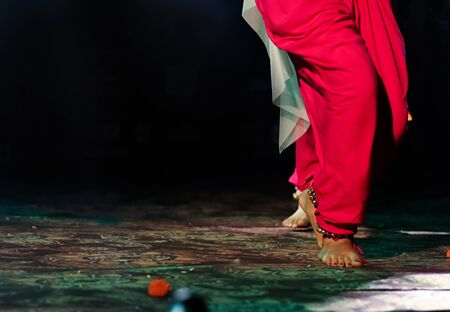 indian classical dance form in feet with musical anklet with selective focus and blur Stock Photo - 129925607