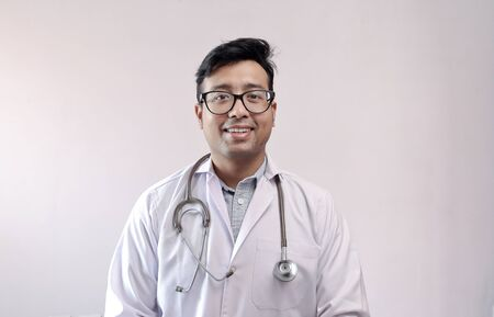 male indian doctor in white coat and stethoscope