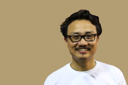 A smiling and confident manipuri north east indian man with spectacles