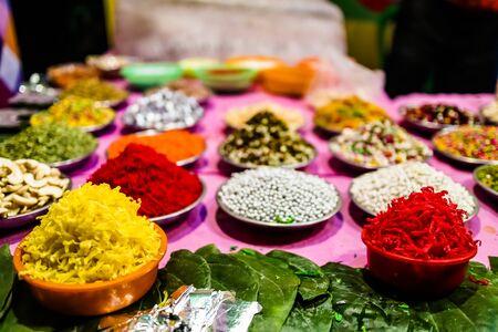 different types of colorful garnish pan masala used to decorate betel leaf banarasi paan.