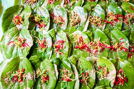 collection of banarasi paan betel leaf with masala displayed with displayed for sale at a shop. Reklamní fotografie