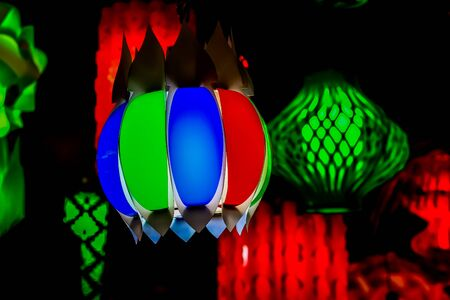 different colored paper chinese electric night lamp hanging from the ceiling on the occasion of chinese lunar new year.