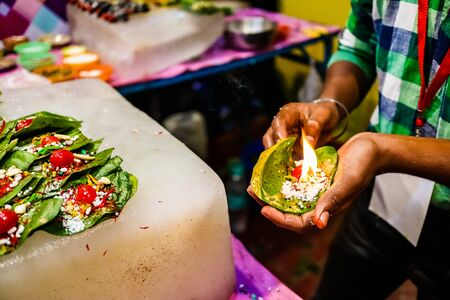 fire paan, a special variety of flaming betel leaf being prepared in the hands of seller