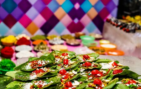 collection of betel leaf banarasi paan and fire paan displayed for sale at a shop with selective focus and blurred background