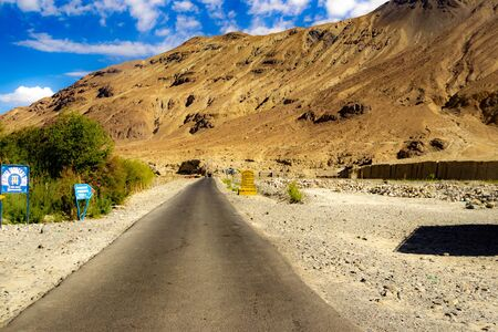 hilly highway in between barren himalayan mountains of leh ladakh, jammu and kashmir, India