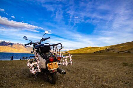 June 27 2016, Tsomoriri, Leh, India. A royal enfield motorbike along with tourist on the bank of lake Tsomoriri in the evening, Leh,India. Redakční