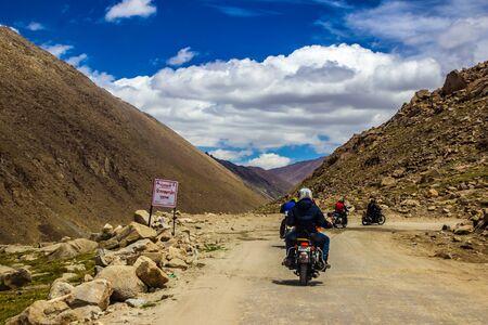 Ladakh,India. 26-June 2016 - Gang of bike riders riding across rocky highway of ladakh, Kashmir, India