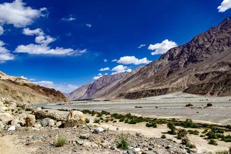 landscape showing vivid deep blue sky and barren dry mountains of ladakh, Kashmir, India