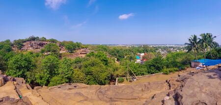 panoramic view of odisha skyline with udaigiri and khandagiri caves. Udayagiri and Khandagiri Caves, formerly called Kattaka Caves or Cuttack caves, are partly natural and partly artificial caves of archaeological, historical and religious importance Reklamní fotografie