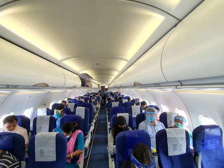 6th June 2020- Netaji Subhas Chandra Bose International Airport, Calcutta, India-passengers in protective gear inside an indigo flight as flight services resume post lockdown In India. Editoriali